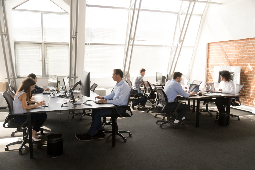 Human Capital Management Image | Workers at Computer in Loft Office Setting