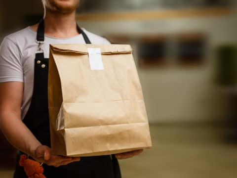 Food Service Sales Growth Employee Delivering Takeout Order