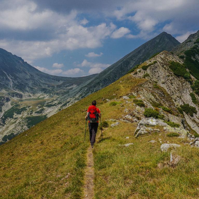 Hiking Across Mountain Ridge | Outdoor Adventure Image